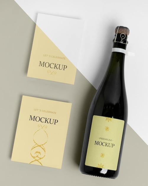 Maquette De Bouteille De Champagne Et Cartes D'invitation Psd gratuit