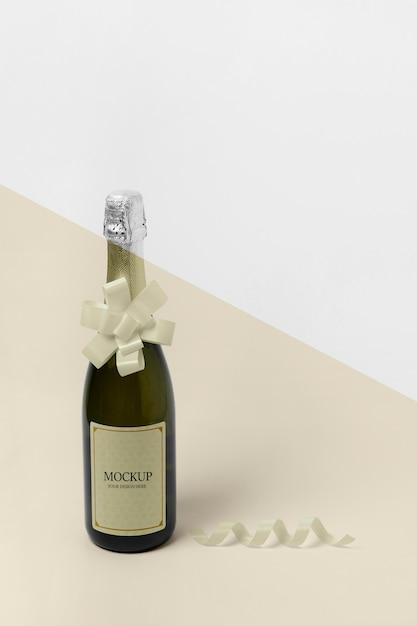 Maquette De Bouteille De Champagne Haute Vue Avec Noeud De Ruban Psd gratuit