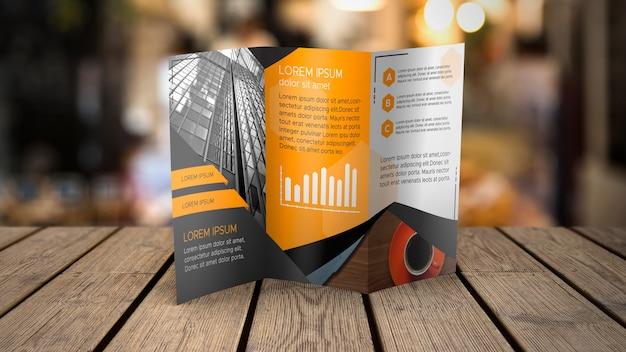 Maquette de brochure à trois volets sur une table Psd gratuit