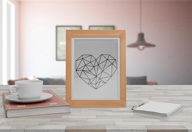 Maquette cadre décoratif sur table à la maison Psd gratuit