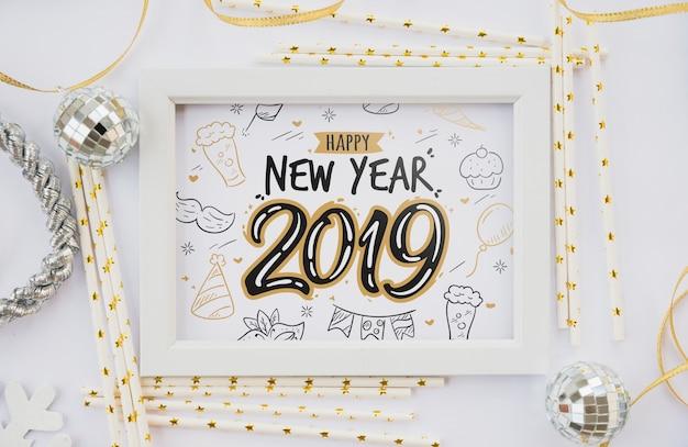Maquette de cadre avec décoration de nouvel an Psd gratuit