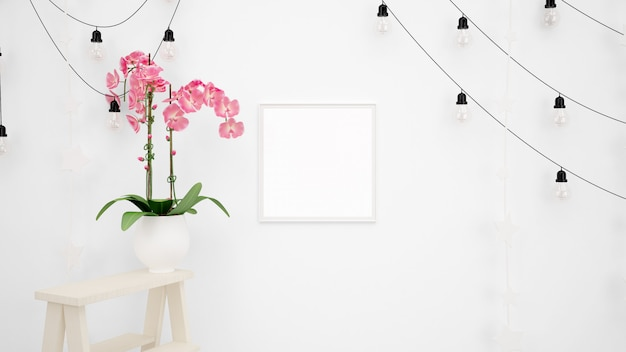 Maquette De Cadre Photo Vierge Avec Des Lampes Suspendues Sur Un Mur Blanc Et Une Belle Fleur Rose Décorative Psd gratuit
