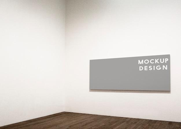 Maquette de cadre rectangulaire sur un mur blanc Psd gratuit