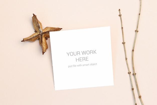 Maquette carte postale avec branche de bois PSD Premium