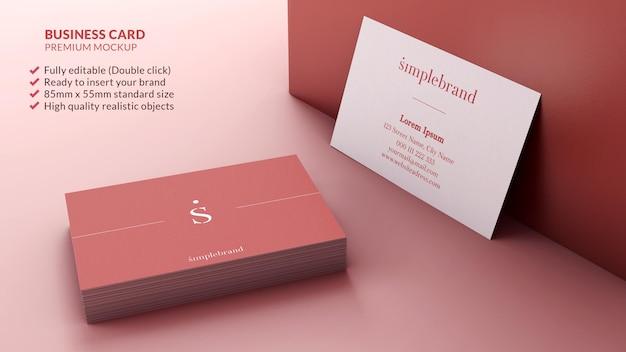 Maquette De Cartes De Visite Dans Une Pile Et Reposant Sur Un Concept De Design De Marque De Mur PSD Premium