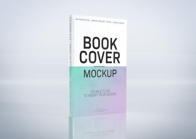 Une maquette d'une couverture de livre sur une surface grise PSD Premium