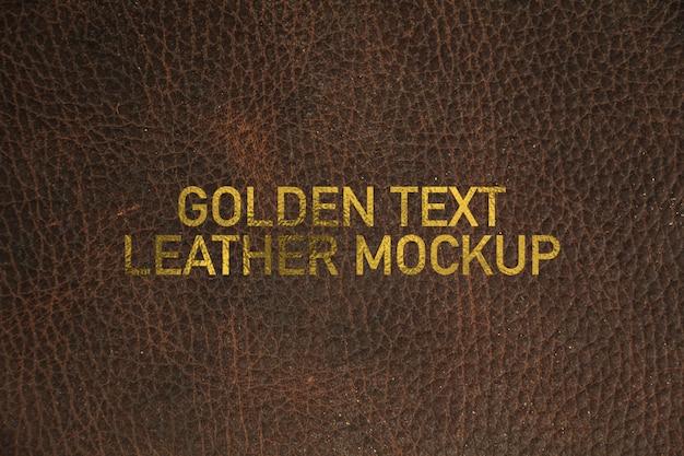 Maquette en cuir texto doré PSD Premium