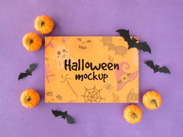 Maquette D'halloween Avec Des Chauves-souris Et Des Citrouilles Psd gratuit