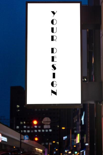 Maquette image d'affiches vierges à l'écran blanc et conduit à l'extérieur de la boutique pour la publicité PSD Premium