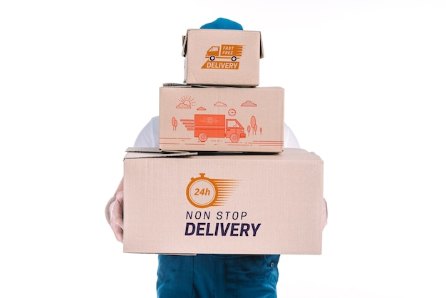 Maquette de livraison avec des boîtes de maintien de l'homme Psd gratuit