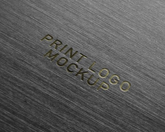 Maquette de logo imprimé d'or PSD Premium