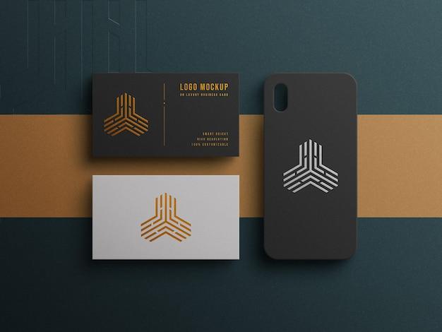 Maquette De Logo De Luxe Sur Carte De Visite Et étui De Téléphone Avec Effet Typographique Et Gaufré PSD Premium