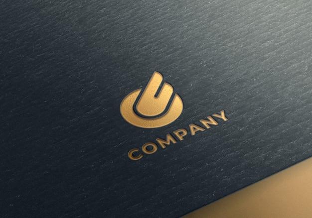 Maquette Logo Or Sur Papier Texturé Noir PSD Premium