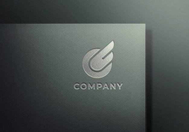 Maquette Logo En Relief Argent Sur Papier Texturé Gris PSD Premium