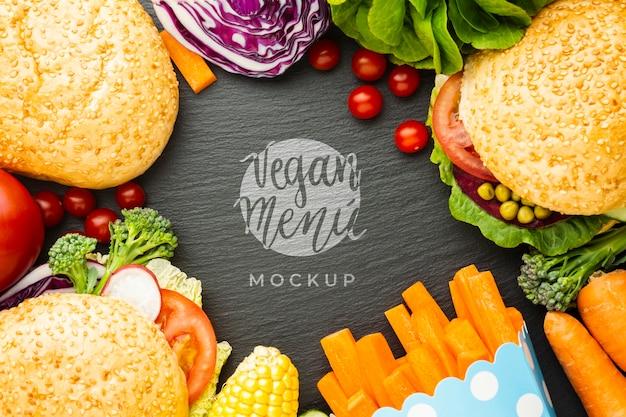 Maquette De Menu Végétalien Entourée De Petits Pains Et De Légumes Psd gratuit