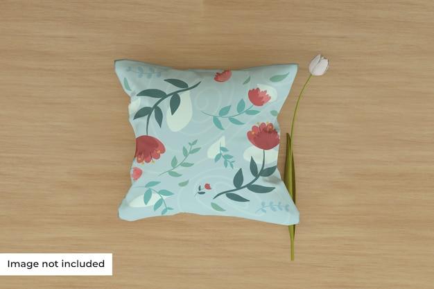 Maquette D'oreiller Sur Le Sol Avec Fleur PSD Premium