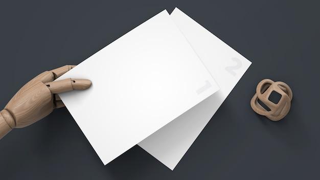 Maquette De Papier à En-tête Dans La Main De Marionnette En Bois PSD Premium
