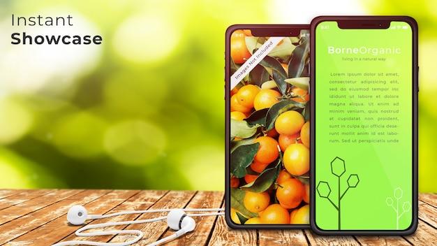 Maquette parfaite de deux tablettes et écouteurs pixel sur une table en bois rustique PSD Premium