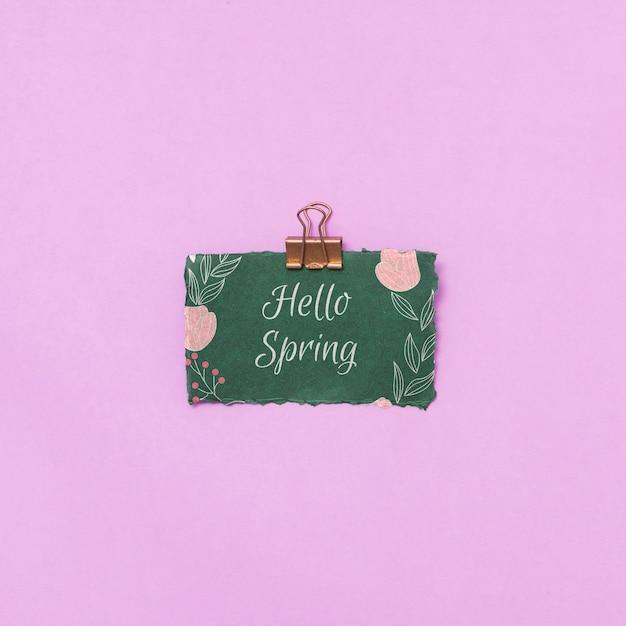 Maquette de printemps plat laïcs avec carte de voeux Psd gratuit