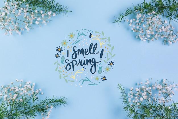 Maquette de printemps à pose plate avec fond et cadre Psd gratuit