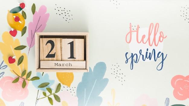 Maquette de printemps à pose plate avec fond Psd gratuit