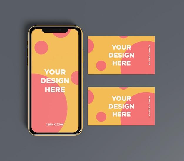 Maquette de smartphone avec double vue de dessus de carte de visite PSD Premium