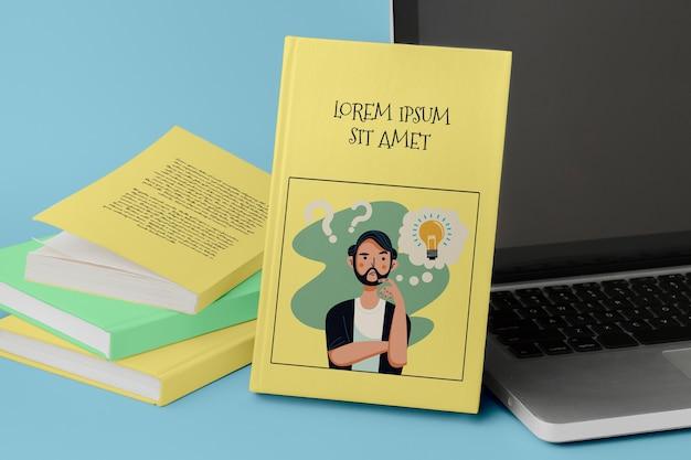 Maquette De Studio De Livres Avec Ordinateur Portable Psd gratuit