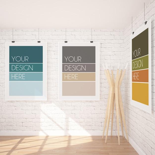 Maquette De Trois Affiches Suspendues Verticales Dans Un Intérieur Moderne Avec Mur De Briques Blanches Et Lampe En Bois PSD Premium