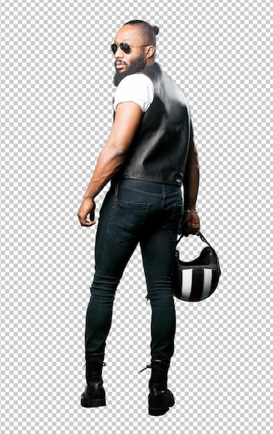 Motocycliste noir complet du corps tenant un casque PSD Premium