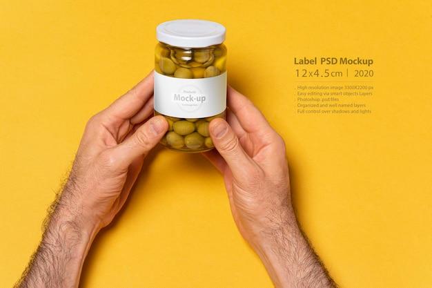 Les Olives Vertes Conservent Un Bocal En Verre Et Une Maquette D'étiquette Avec Un Capuchon Rond PSD Premium
