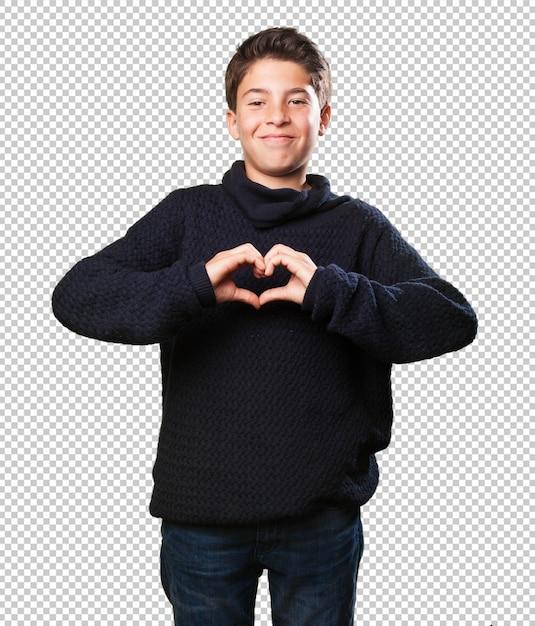Petit garçon fait un symbole du coeur PSD Premium