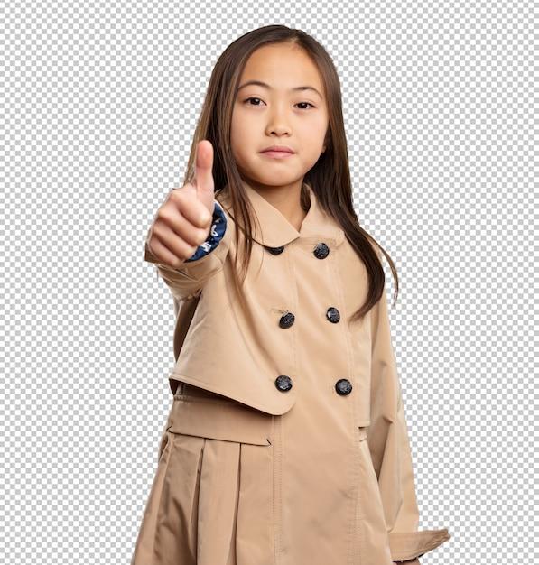 Petite fille chinoise faisant bon geste PSD Premium