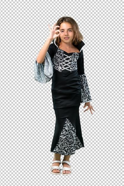 Petite fille habillée comme un vampire pour les vacances d'halloween montrant un signe ok avec les doigts PSD Premium