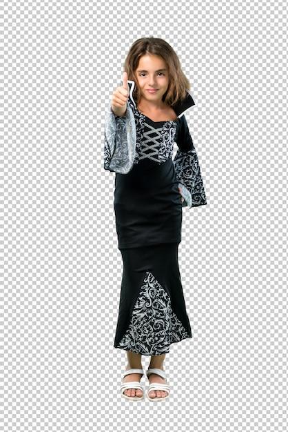 Petite fille habillée en vampire pour les vacances d'halloween en levant le geste et en souriant PSD Premium