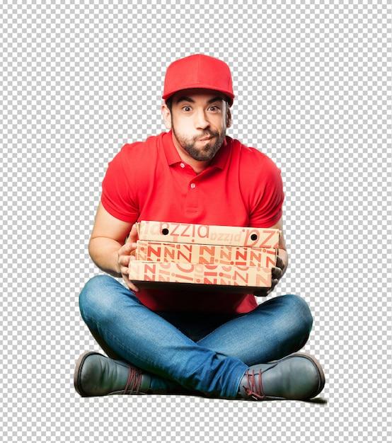 Pizza dealer assis tenant une boîte à pizza PSD Premium