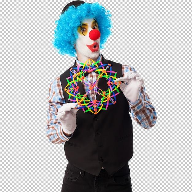 Portrait d'un clown drôle jouant avec une balle de jouet PSD Premium
