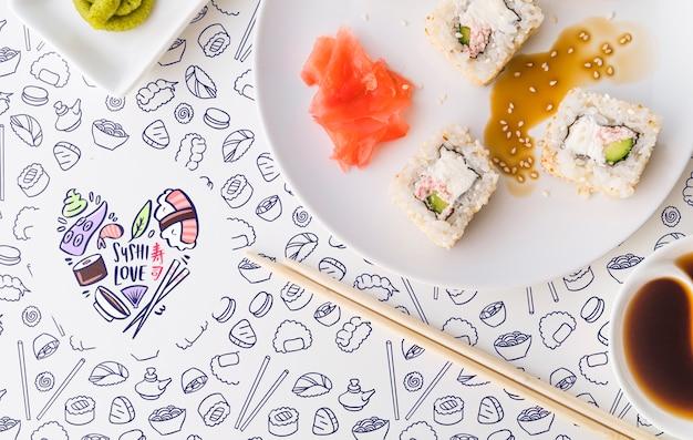 Pose à plat d'une assiette de sushi et de sauce soja Psd gratuit
