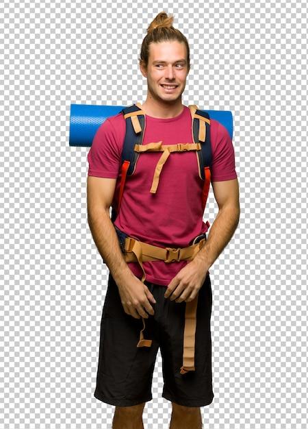 Randonneur homme avec mountain backpacker est un peu nerveux et peur en appuyant sur les dents PSD Premium