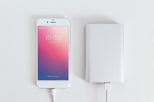 Smartphone maquette avec câble de charge Psd gratuit