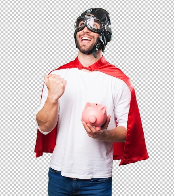 Super héros tenant une tirelire PSD Premium