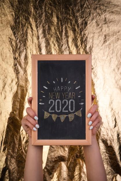 Tableau En Bois Encadré Pour La Fête Du Nouvel An 2020 Psd gratuit