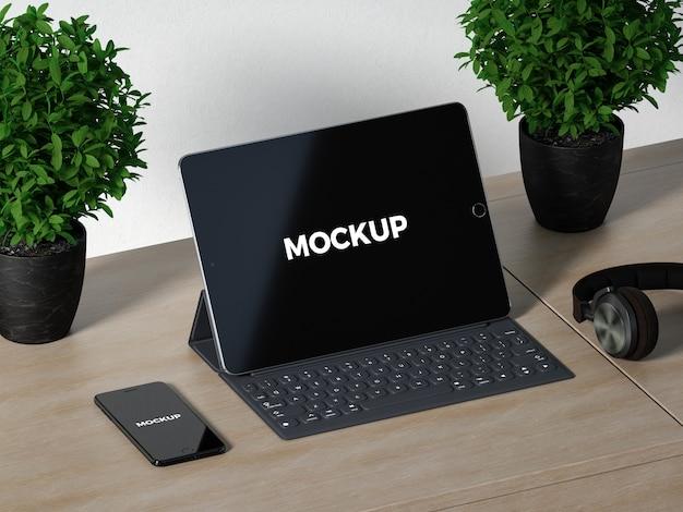 La tablette sur le bureau en bois se moque PSD Premium