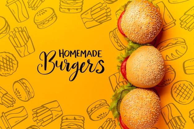 Tas De Hamburgers Sur Fond De Doodle De Restauration Rapide Psd gratuit