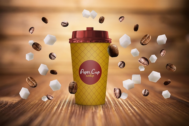 Tasse à Café En Papier Et Grains En Maquette Par Gravité Psd Gratuit PSD Premium