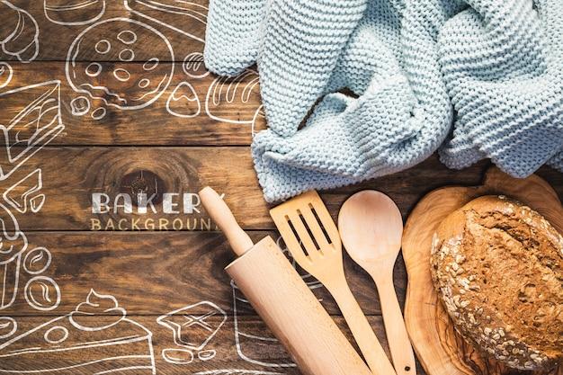 Ustensiles de cuisine avec du pain blanc frais Psd gratuit