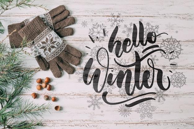 Vue de dessus bonjour l'hiver avec des gants chauds Psd gratuit