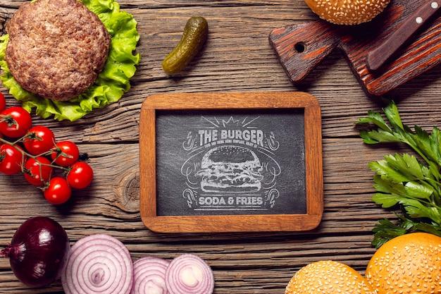 Vue De Dessus Cadre Ingrédients Burger Fond En Bois Psd gratuit