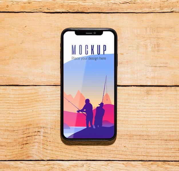 Vue De Dessus Du Smartphone Avec Pêche Psd gratuit