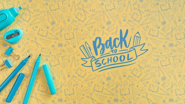 Vue De Dessus Fournitures Bleues Pour Le Premier Jour D'école Psd gratuit