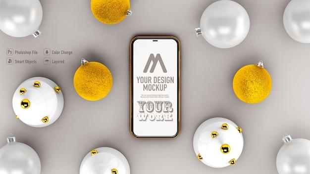 Vue De Dessus De La Maquette Mobile à Côté De La Décoration De Noël Isolée PSD Premium